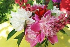 bunch of peony, lupine and lily flowers - stock photo