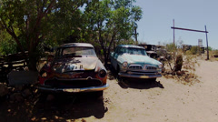 1950s Era Cars Rusting In Peace In Desert On Route 66 - stock footage