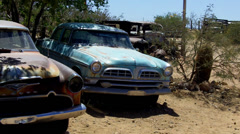 1950s Era Sedan Cars Rusting Along Route 66- Hackberry AZ - stock footage