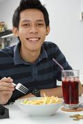 Man with fast food Stock Photos