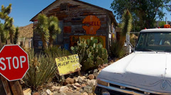 300 Miles Desert Ahead Sign At Old Roadside Garage- Hackberry AZ Stock Footage