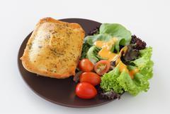 Chicken pie with salad Stock Photos