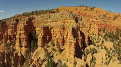 Aerial flight down red rock mountain pinnacles Utah HD 121 Stock Footage