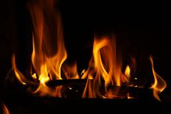 Fire in a fireplace, fire flames on a black background Stock Photos