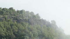 Time lapse with drifting fog over the Mountain valley Stock Footage