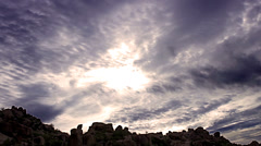 Amazing timelapse sky over rocky hill. Stock Footage