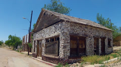 Derelict Stone House And Street In Small Town Stock Footage