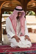 young muslim man praying - stock photo