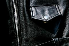 high contrast black leather jacket detail - stock photo
