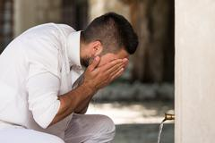 islamic religious rite ceremony of ablution face washing - stock photo