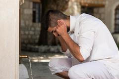 islamic religious rite ceremony of ablution ears washing - stock photo