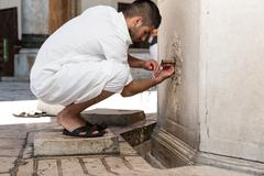 islamic religious rite ceremony of ablution hand washing - stock photo