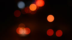 Abstract blurred colorful circles on road in night, suitable as a background Stock Footage