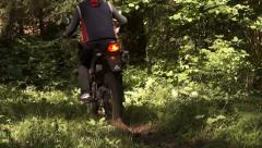 On a motorcycle on a forest path Stock Footage