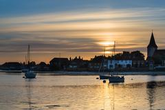 landscape tranquil harbour at sunset with yachts in low tide - stock photo