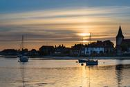 Stock Photo of landscape tranquil harbour at sunset with yachts in low tide
