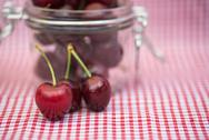Stock Photo of glass storage jar full of fresh cherries