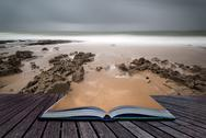 Stock Illustration of long exposure landscape beach scene with moody sky creative concept