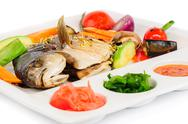 Stock Photo of fried wish with grilled vegetables and sauces