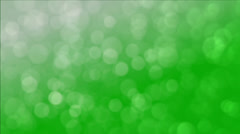 Looping background of green bokeh particle imagery Stock Footage