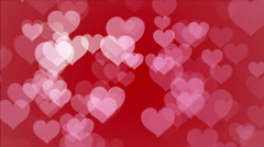 Looping background of hearts with bokeh particle imagery effects Stock Footage