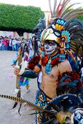 Aztec Warrior represented by a person with costume and accessories - stock photo