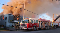 Firetruck setting up aerial ladder Stock Footage