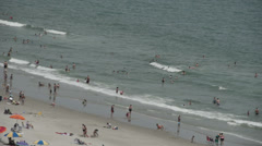 1820 People Enjoying the Beach with Ocean Waves in Slow Motion - stock footage
