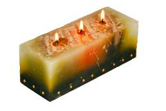 Large rectangular candle with three lighted wicks Stock Photos