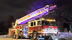 Bright fire truck with ladder at night Stock Footage