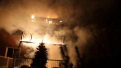 House fire with walking camera motion Stock Footage