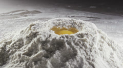 Egg in the middle of bleached wheat flour Stock Footage