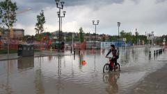 Man on bicycle deep in flood water Stock Footage