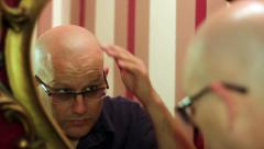 Bald man looking in the mirror III Stock Footage