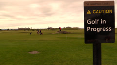 Golf in Progress at the Royal and Ancient Golf Club of St Andrews Stock Footage