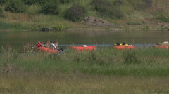 People boating with a boat in a river, riverside Stock Footage