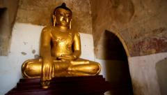 Golden Buddha statue inside Bagan temple Stock Footage