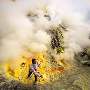 Sulfur Miner at Work Inside Crater of Kawah Ijen, Indonesia Stock Photos
