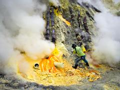 Sulfur Miner at Work Inside Crater of Kawah Ijen Volcano, Java, Indonesia - stock photo