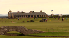 Bridge and golfers at Royal and Ancient Golf Club of St Andrews Stock Footage