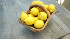Stock Video Footage of Lemons in a basket on a wooden table. HD shot with slider