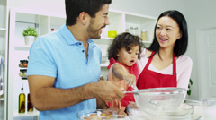 Asian Chinese Parents Infant Girl Red Apron Kitchen Fun Together - stock footage