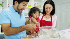 Happy Young Ethnic Family Home Kitchen Cake Baking Stock Footage