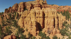 Aerial flight up red rock mountain towers Utah HD 116 Stock Footage