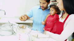 Ethnic Parents Infant Daughter Baking Together Kitchen Stock Footage