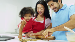 Ethnic Parents Infant Daughter Baking Cookies Together Kitchen Stock Footage