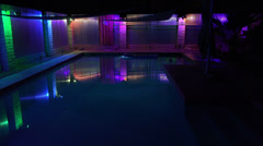Wide Serene pool setting color changing lighting est shot 6 Stock Footage