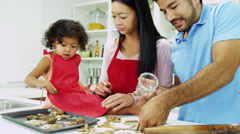 Young Ethnic Parents Happy Infant Daughter Home Kitchen Baking - stock footage