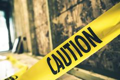 Yellow caution tape closeup. constriction zone safety. Stock Photos
