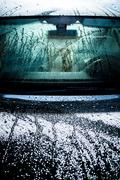 Waxed car body covered by water. Stock Photos